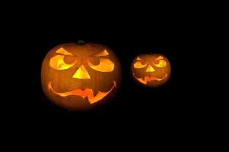 ghastly halloween pumpkin on black background Stock Photo - 11594645
