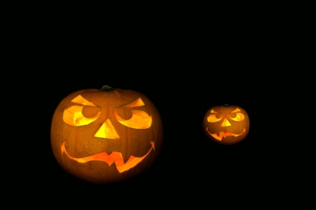 ghastly halloween pumpkin on black background photo