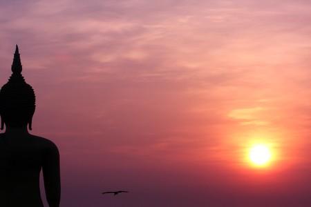 One Of The World Biggest Buddha Image With Sunrising, AngThong-Thailand photo