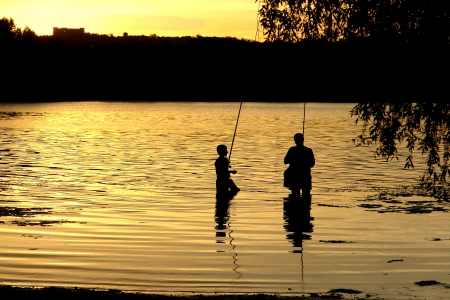 Father and son on fishing                                photo