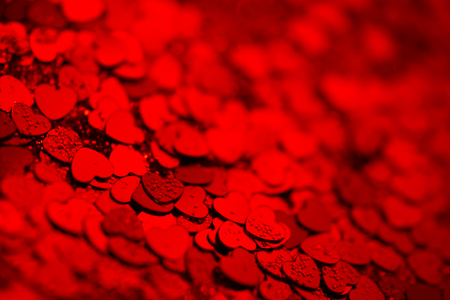 Red hearts confetti texture. Happy Valentines day background.