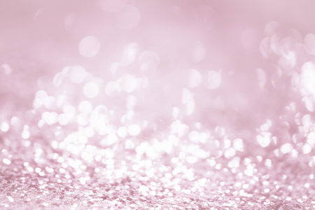 Rose gold glitter confetti defocused background texture. 版權商用圖片