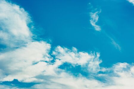 Blue sky with white clouds in sunlight. Summer background
