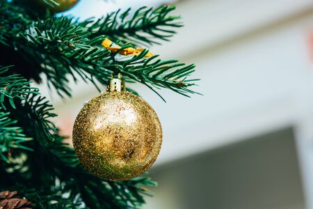 Merry christmas background. Green fir tree with golden balls and ribbon. Foto de archivo