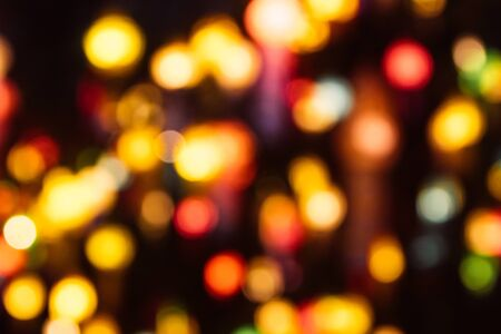 Christmas holiday golden lights bokeh background. New Year blurry walpaper.