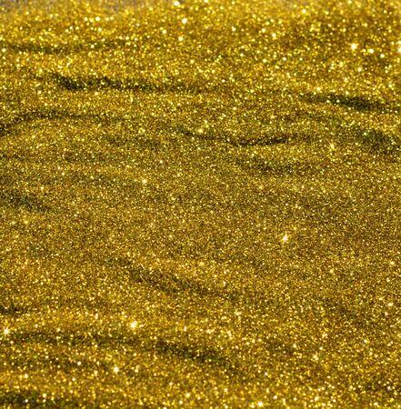 Glittering golden texture. New year background.