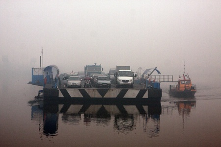 oka: 07 of August 2010. The Oka river in the smoke in Moscower region. Ferry is mooring