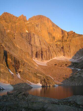 longs peak: Sunrise on the East Face of Longs Peak, Rocky Mountain National Park Stock Photo