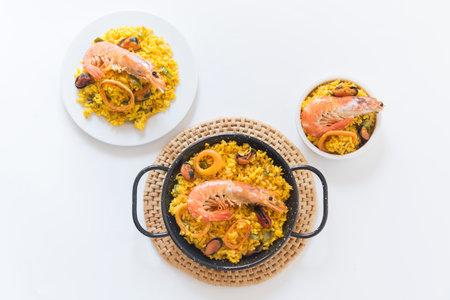 Paella typical spanish food in granite background 写真素材