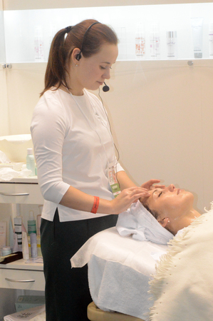 chiropodist: Intercharm XXI International Exhibition Young brunette woman doing adorns-rejuvenating treatments