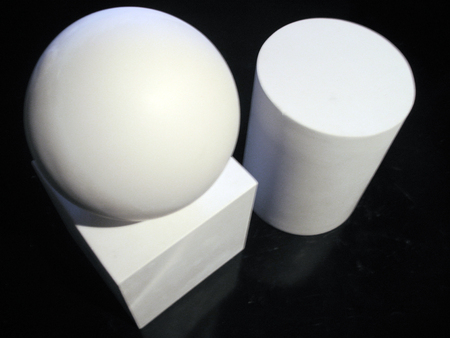staging: Gypsum ball, cube, cylinder on the black background Stock Photo