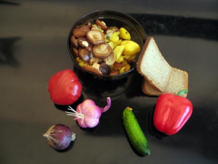 fried potatoes: Fried potatoes, marinated mushrooms, black bread, pepper, tomato, onion, garlic, cucumber on a black background Stock Photo