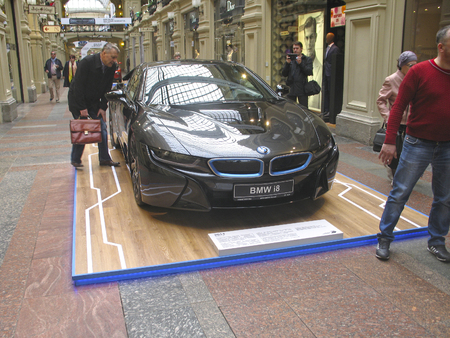 bmw: 100 years of the BMW. The State Department Store. Moscow. BMW i8. Sport car Editorial