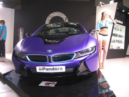 Pandora and BMW. The girl from the BMW team works on exhibition. Moscow International Auto Show 2016