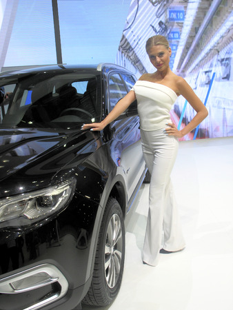 skintight: Girl model near to the machine. Moscow International Auto Show 2016. August 29th, 2016 Moscow. Russia Editorial