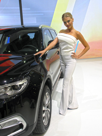 Girl model near to the machine. Moscow International Auto Show 2016. August 29th, 2016 Moscow. Russia Editorial
