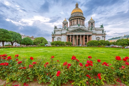 St. Isaacs Cathedral in cloudy weather with flowers on the foreground