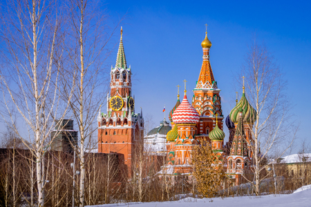 St. Basils Cathedral and Spassky Tower in the winter morning with birch Stock Photo