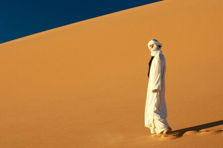 nomad: young woman in sahara desert