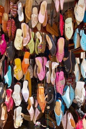 Colorful arabic shoes alignment in a shop  photo
