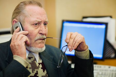 Mature businessman talking on the phone photo
