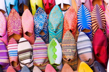 alignment: Colorful arabic shoes alignment in a shop Stock Photo