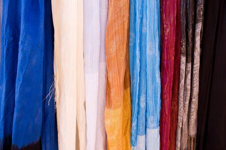 market stall: Selection of wonderfully bright colourful cloth at a market stall in Marrakesh
