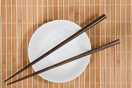 arrangment: Simple arrangment of chopsticks, mat and  empty bowl