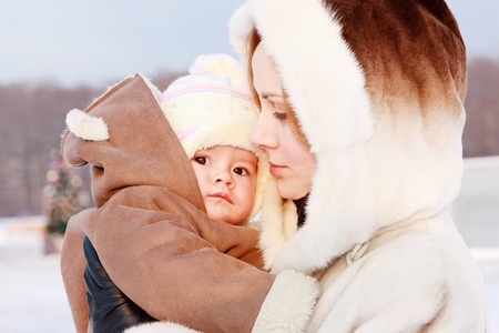 Mother with baby in winter photo