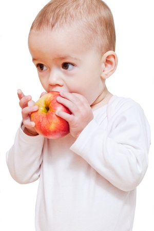 Baby girl eating healthy food isolated photo