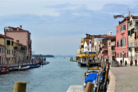 Venedig (Venice) City views during sunny day. Magnificent city of gondolas, ancient houses, old bridges, green water and channels, birds, seagulls. All these are in Venice, Italy.
