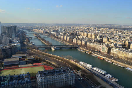 View of City Paris from Eiffel Tower. Panoramic Paris city view and Seine River from the most well know building of France: Top of Eiffel Tower.