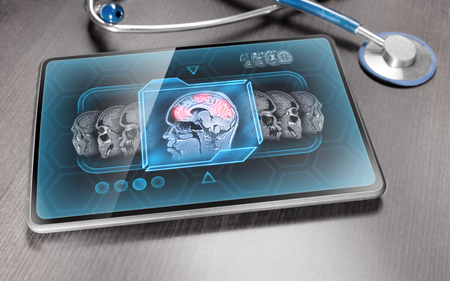 Medical tablet on wooden table displaying activity of human brain Stok Fotoğraf