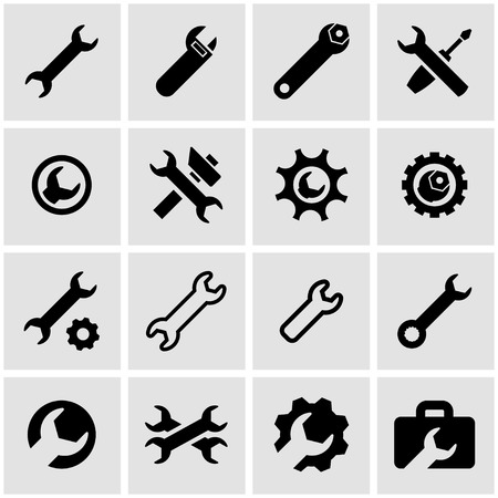 black settings wrench icon set on grey background