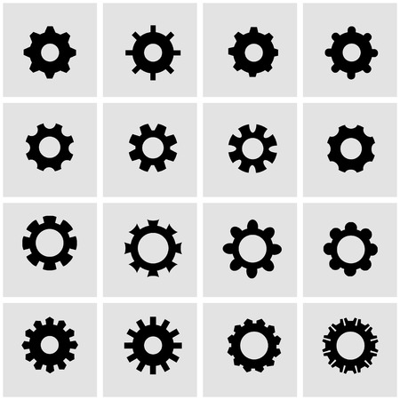 gears and cogs: Vector black gear icon set on grey background