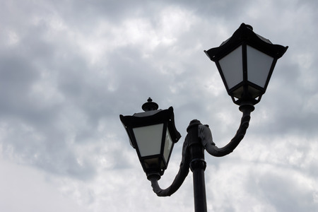 Street lamp on the background of clouds Stock Photo