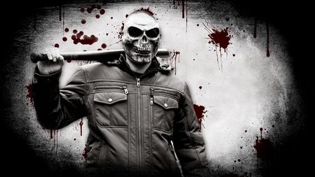 Maniaque sanglant dans un masque avec une batte de baseball Banque d'images