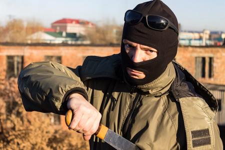 Threatening thug gets a gun