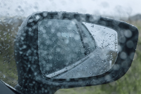 Car rearview mirror with raindrops