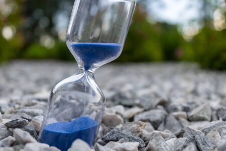 Hourglass with beautiful blue sand