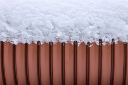 Background, texture of the outer wall of the sewer pipe with snow on top Imagens