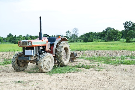 dirty tractor on farm photo
