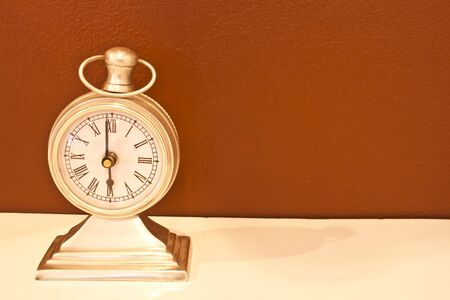 Vintage clock on table. photo
