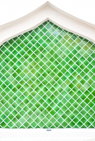 Tiled wall with bunch of green tiles  photo