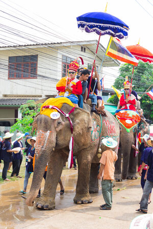SUKHOTHAI - APRIL 7   Songkran Festival and Hadxiao Elephant Ordains at Si Satchanalai from April 7 to 8, Riding on elephant and Thai Puan elephant ordination on April 7, 2014 in Sukhothai  Stock Photo - 27559421
