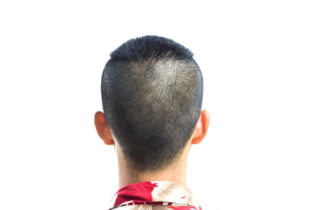 A closeup of the back of a young mans head and neck isolated over a white background  photo