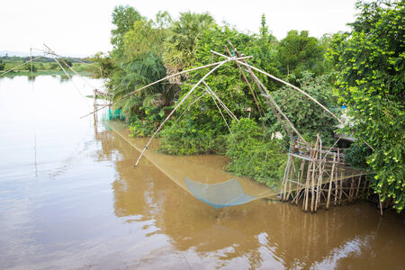 Water scape scene with square dip net in Patthalung,Thailand Traditional fishing photo