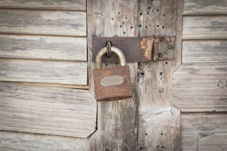 circumspect: Old master key with wooden door