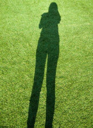 woman  shadow: Woman shadow on grass. Stock Photo