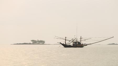 Fishing ship and morning sea at Chumphon, Thailand photo